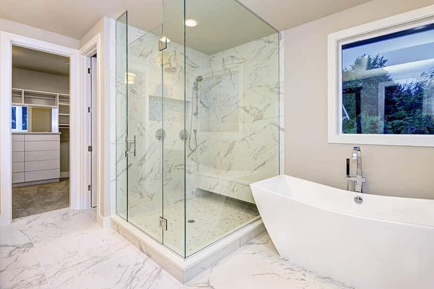 Bathroom with cultured marble shower freestanding tub and beige walls