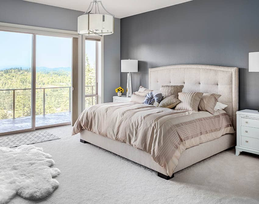 Bedroom with nylon carpet gray painted walls