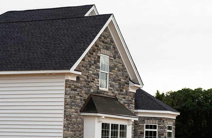 Black roof shingles on house