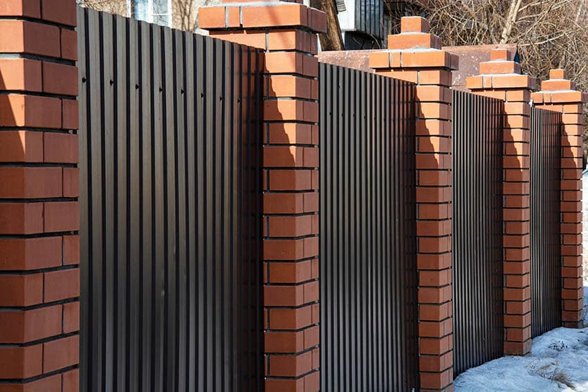 Brick and corrugated metal fencing