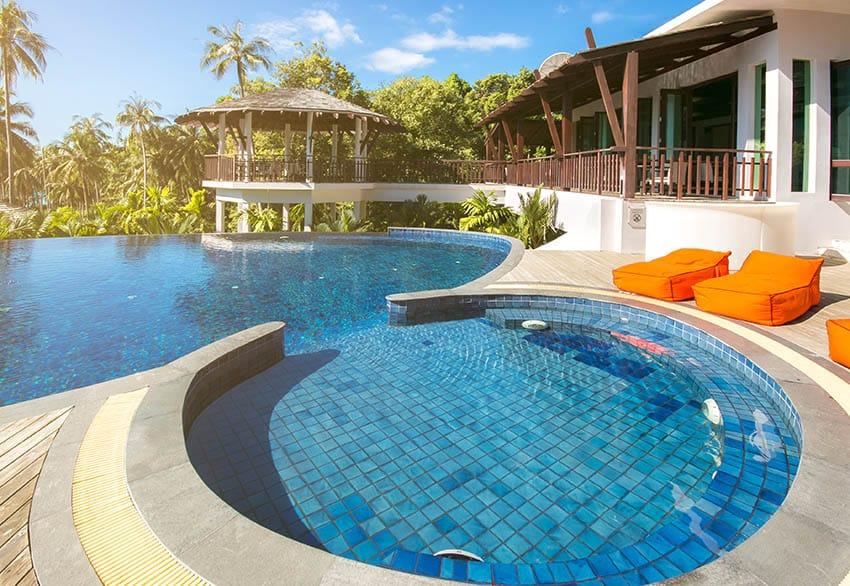 Ceramic tile swimming pool with infinity edge design