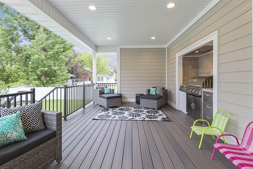 Composite deck with outdoor kitchen nook furniture