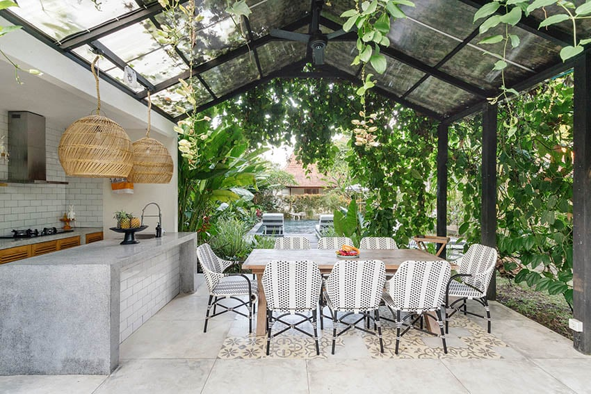 Concrete patio with outdoor kitchen with concrete countertops canopy cover