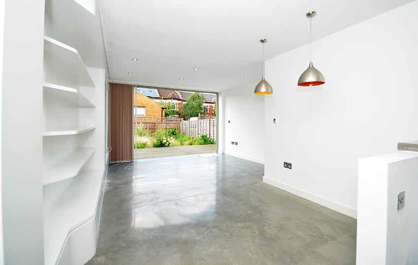 Condo home with polished concrete floors in living room