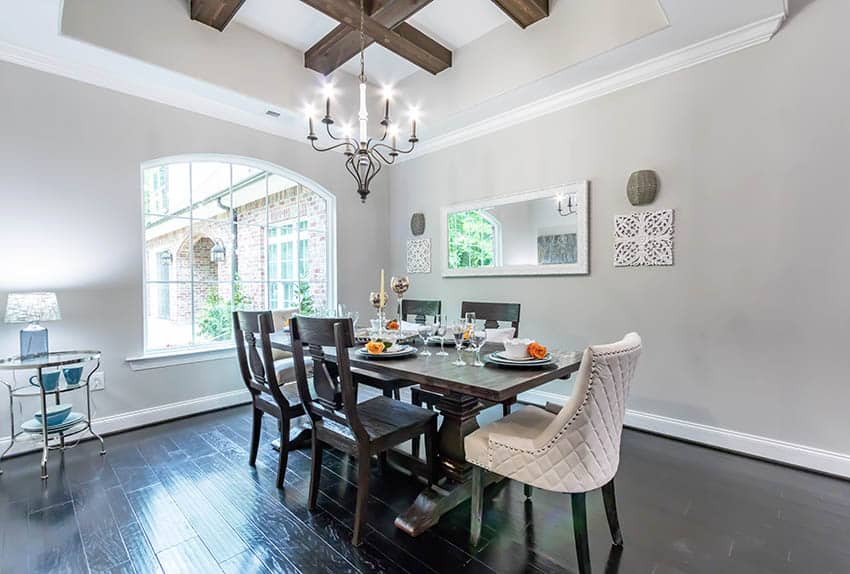 Contemporary dining room with different chair sizes