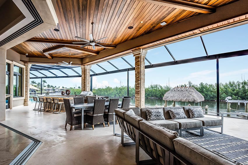 Covered polished concrete patio with indoor outdoor living waterfront views