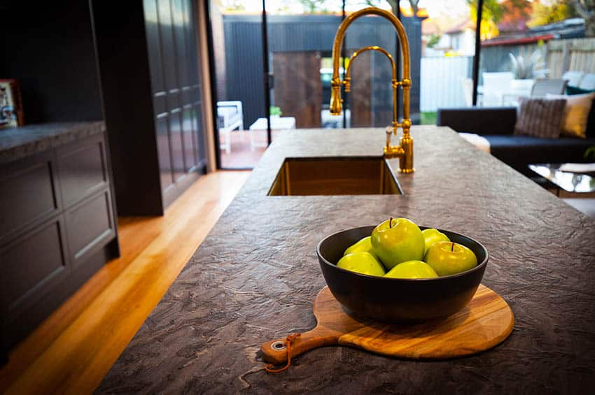 Dark gray leathered granite countertops with gold finishes black cabinets kitchen