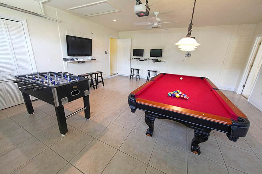 Garage man cave conversion with pool table foos ball porcelain tile floor