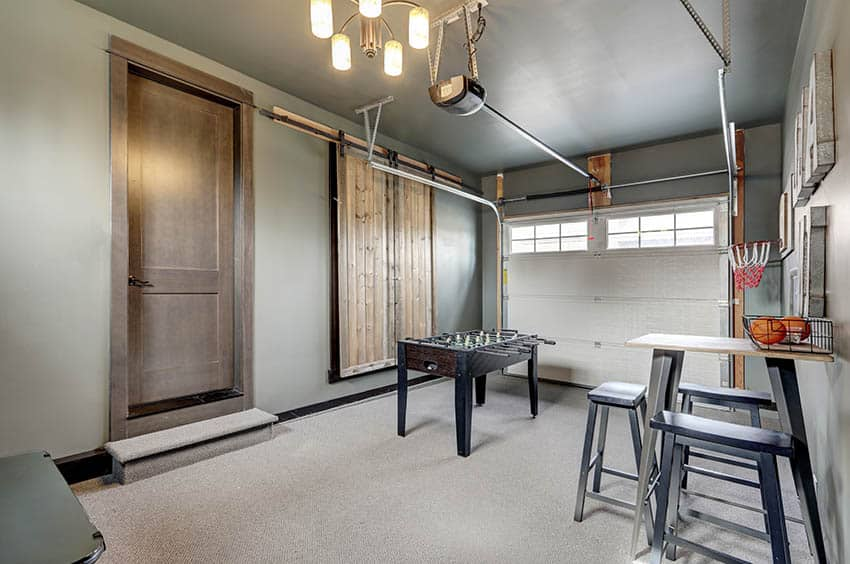 Garage man cave with carpet foos ball table small table chairs