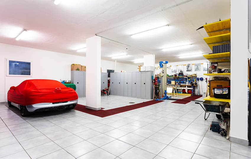 Garage with tile floors locker storage as partition wall