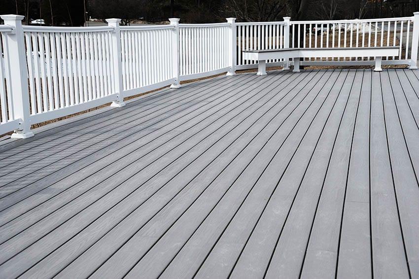 Gray pvc deck with white railing
