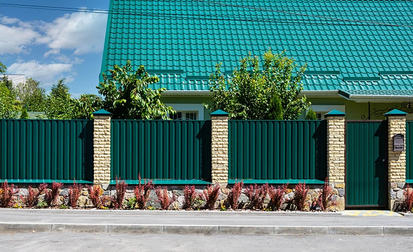 Green metal corrugated fence