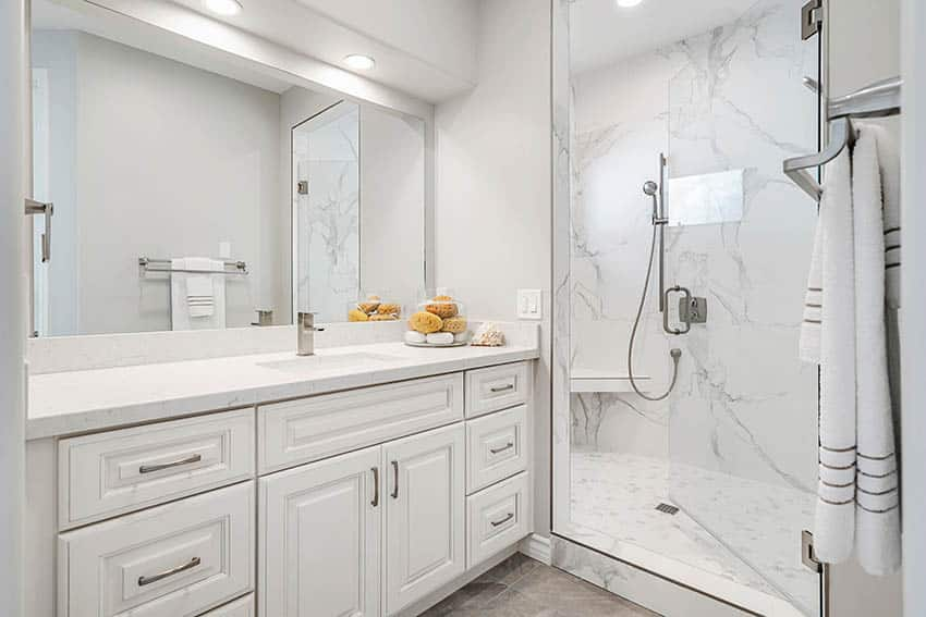Guest bathroom with cultured marble shower vanity white cabinet