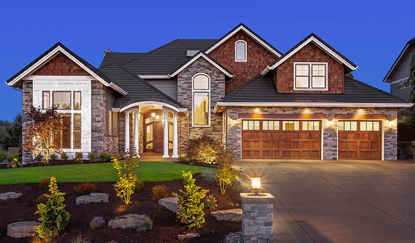 House with black roof shingles three car garage