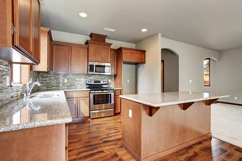 Kitchen with laminate countertops that look like granite