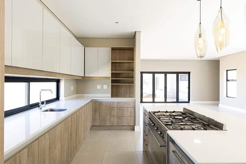 Kitchen with white laminate countertops