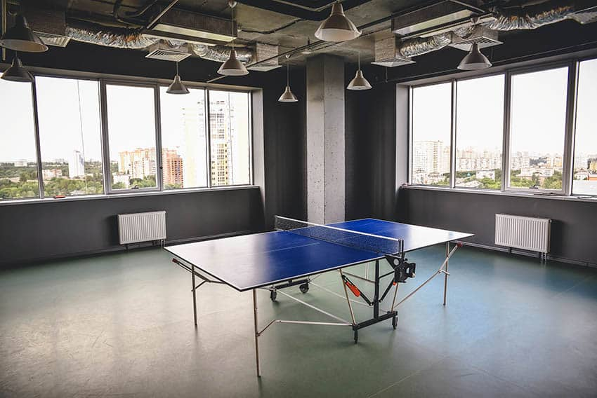 Large game room with gray epoxy floors and table tennis