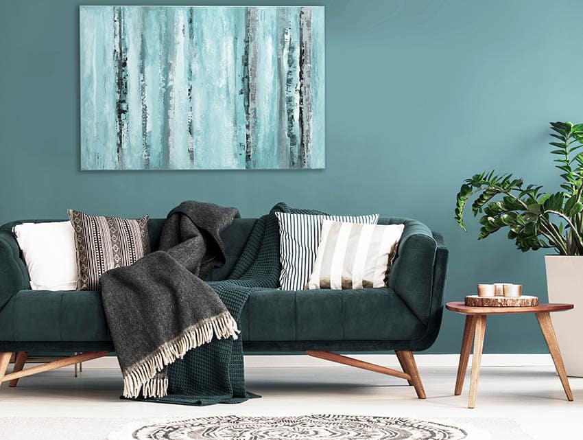 Living room with green mid century modern polyester sofa