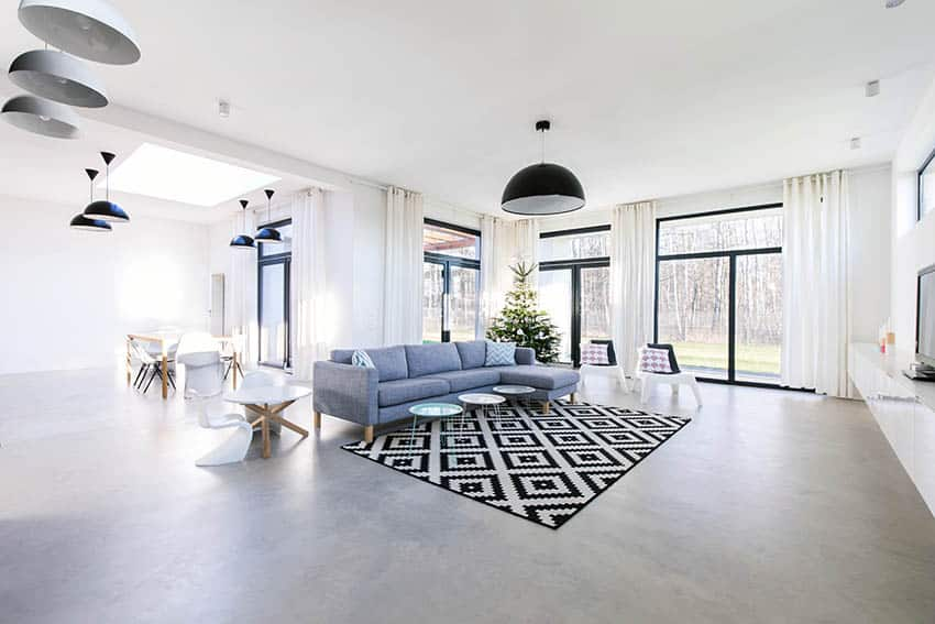 Living room with polished gray concrete flooring