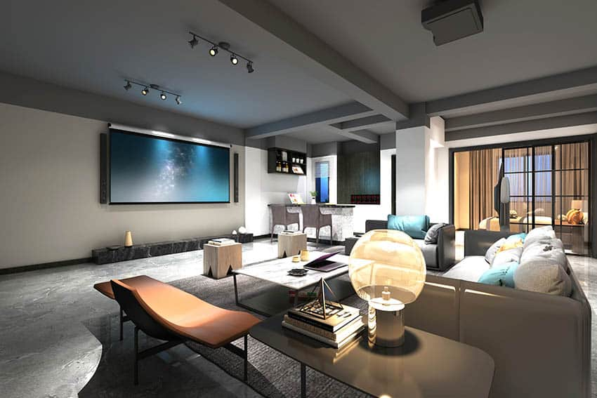 Luxury man cave with stained concrete flooring large projector tv home bar sofas