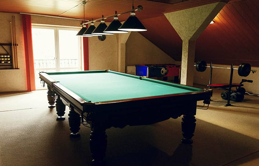 Man cave with berber carpet pool table weight bench
