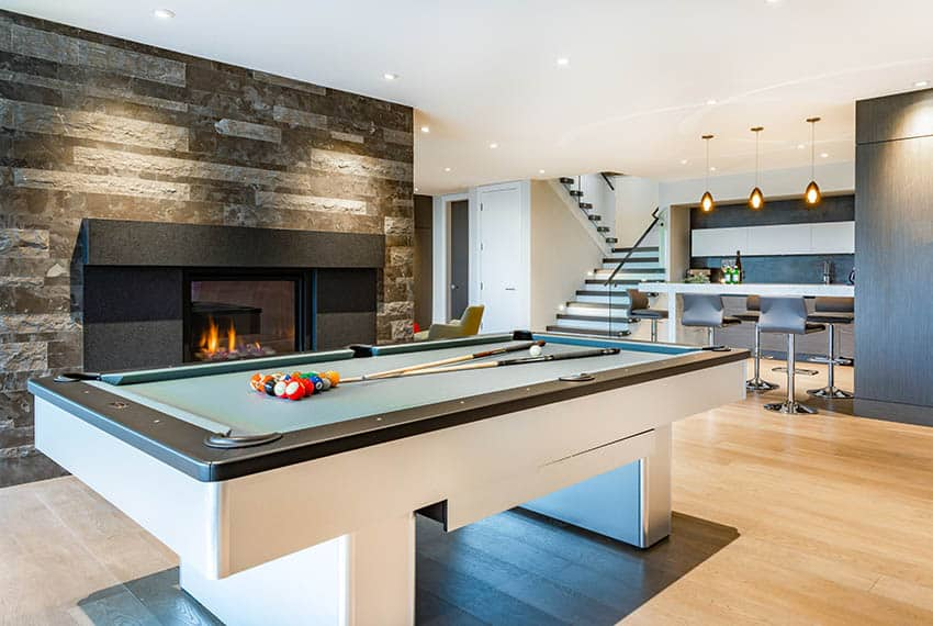 Man cave with light color laminate flooring and pool table