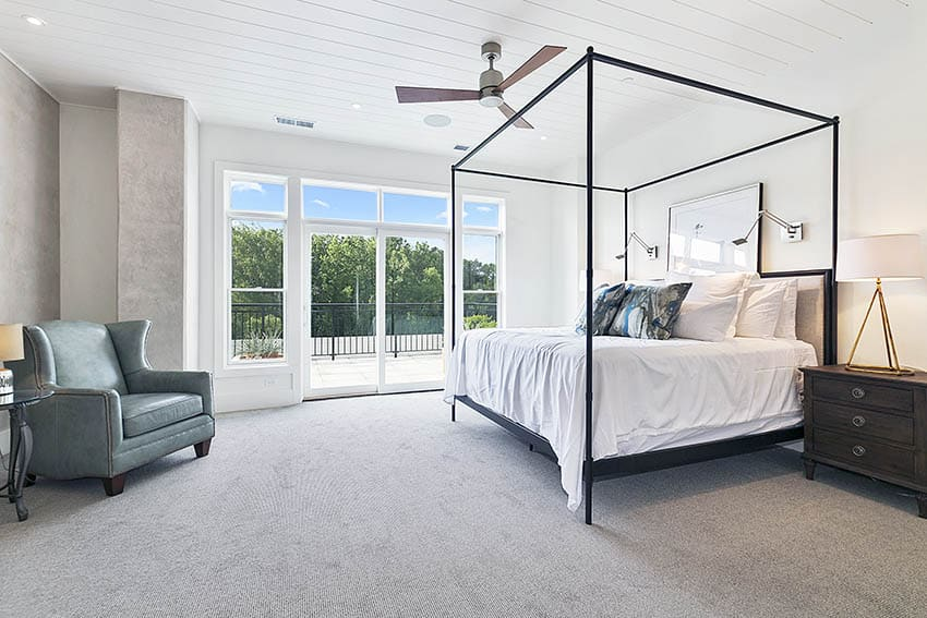 Master bedroom with polyester carpet four post bed