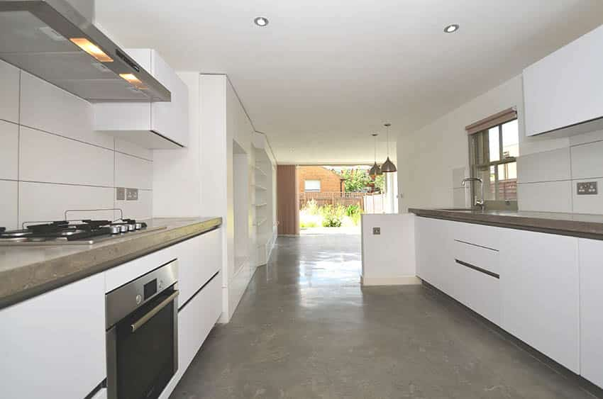 Modern gallery kitchen with grind and seal polished concrete floors