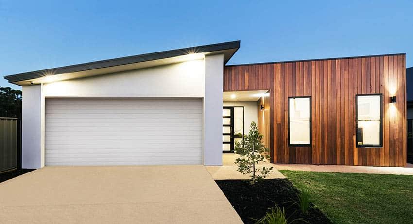 Modern house with salt finish concrete driveway design
