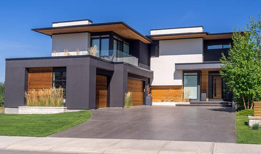 Modern house with stained concrete finish driveway