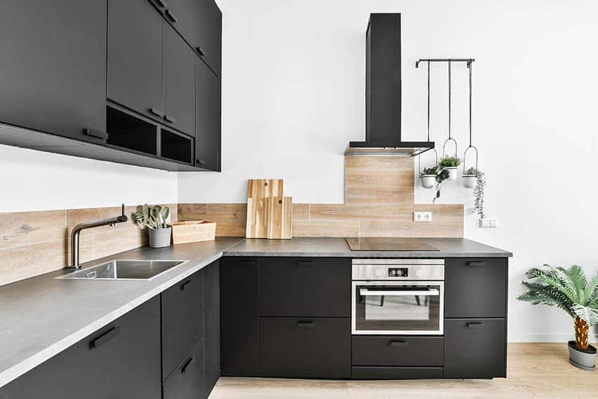 Modern kitchen with light gray laminate countertops black cabinets
