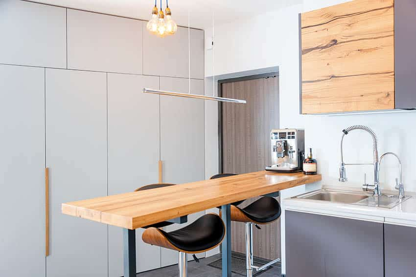 Modern kitchen with spectator height bar stools