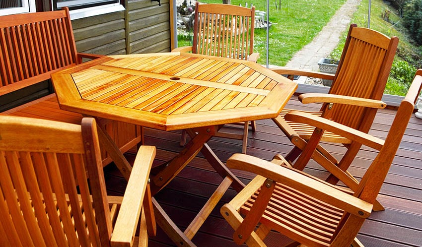 Outdoor acacia wood chairs table on deck