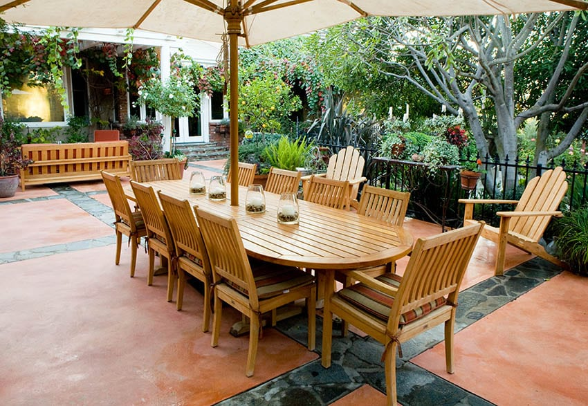 Outdoor patio with acacia wood dining table Adirondack chairs and bench