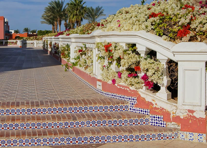 patio with spanish tile steps and red brick pavers