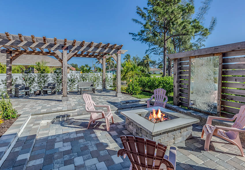Paver patio with stone fire pit water feature