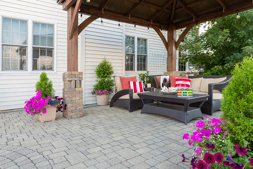 Paver patio with wood canopy outdoor furniture
