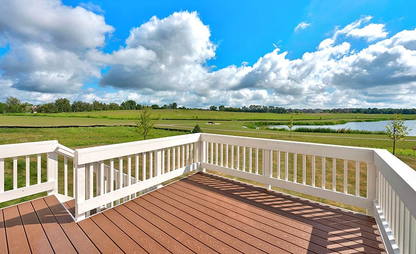 Raised composite deck with white railing