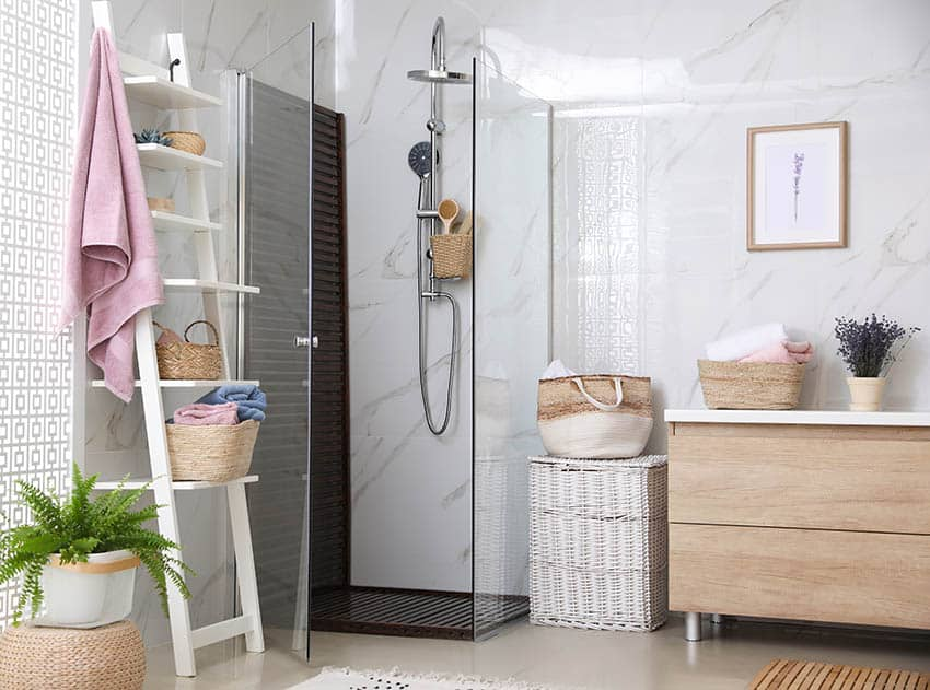 Small bathroom with cultured marble shower enclosure and walls