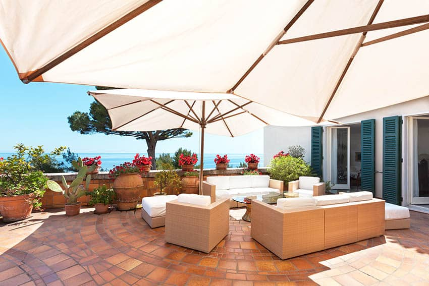 Spanish saltillo tile patio with outdoor furniture and umbrella