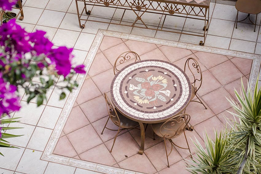 spanish style patio with light pink ceramic tiles