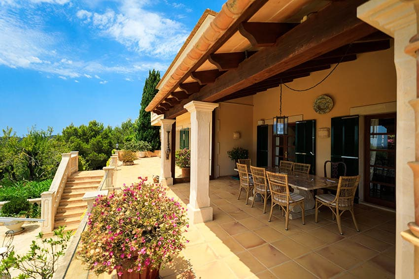 Spanish style terrace patio with gold tiles