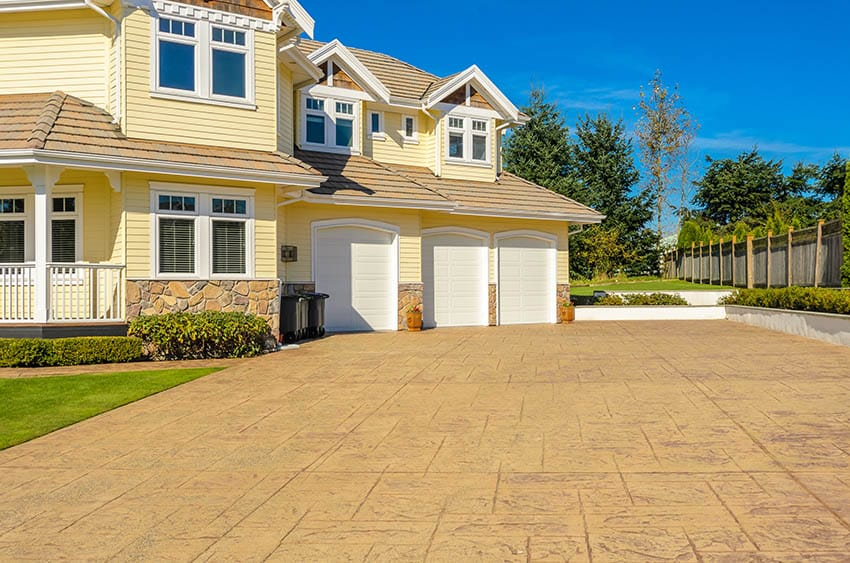 Stamped concrete driveway house