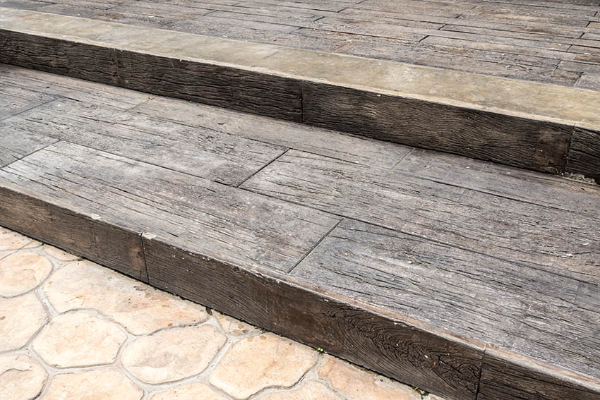 Stamped concrete wood look plank patio with steps