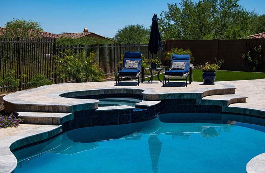 Swimming pool with medium gray plaster finish