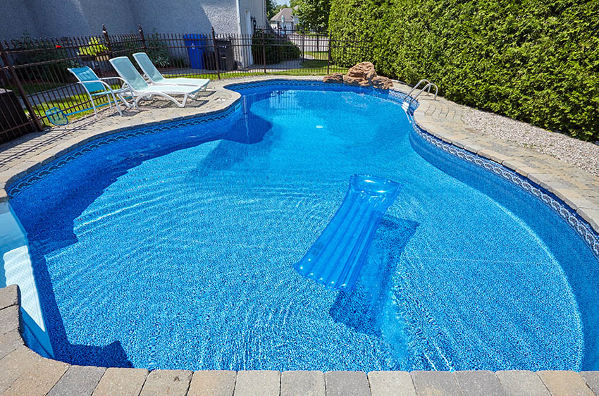 Swimming pool with pebble finish