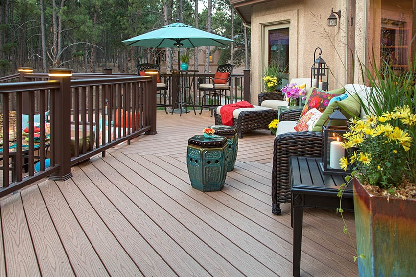 Wood look composite deck with dark color railing