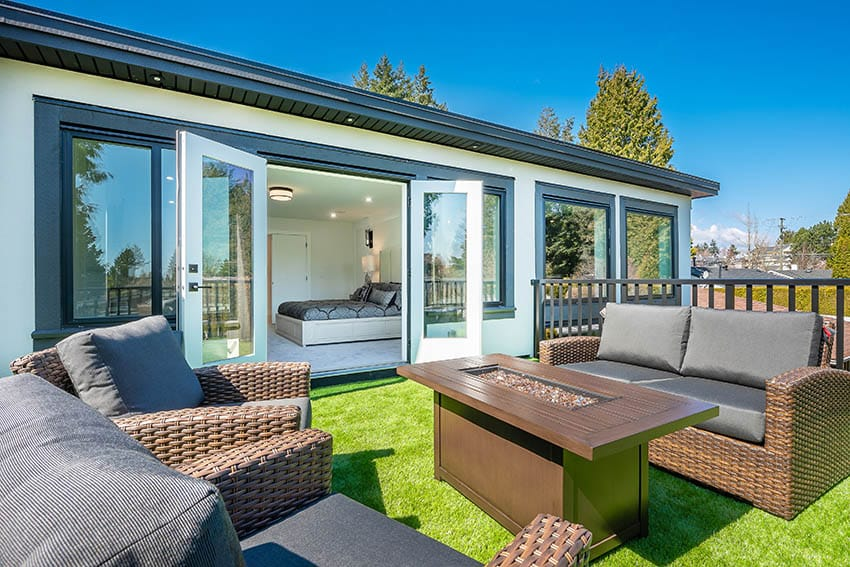 Artificial grass patio on rooftop with entry to master bedroom