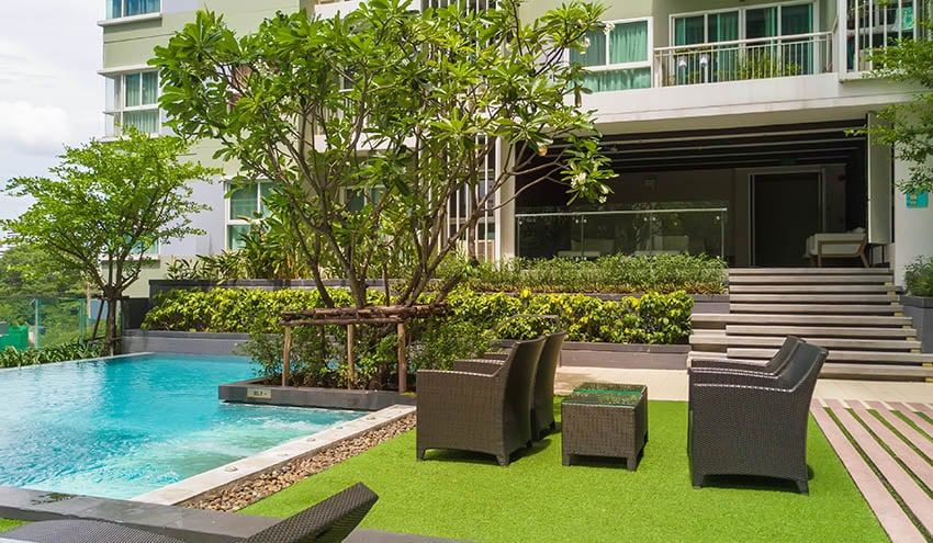 Artificial grass pool patio with sitting area