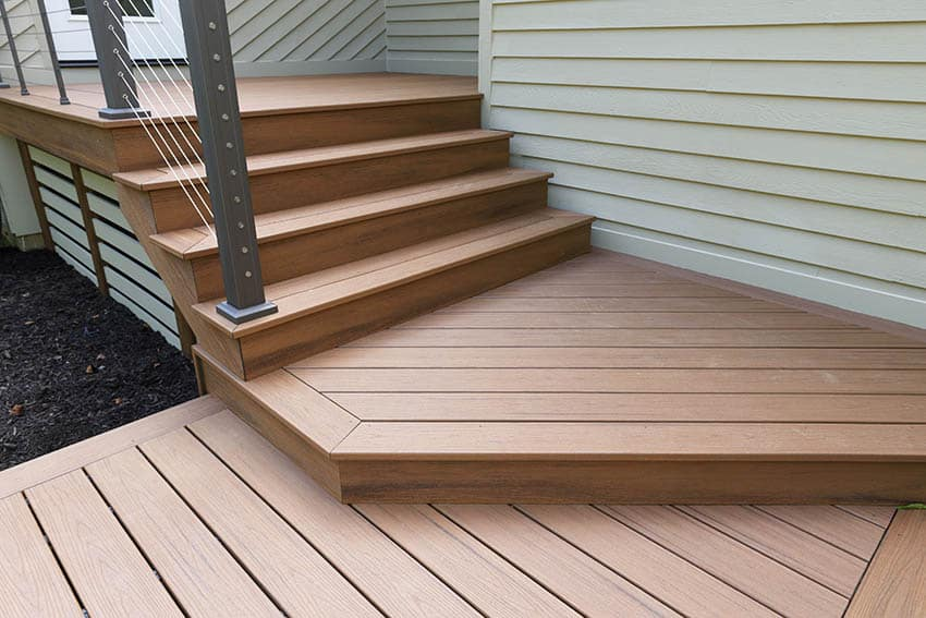 Azek decking steps to house with modern railing